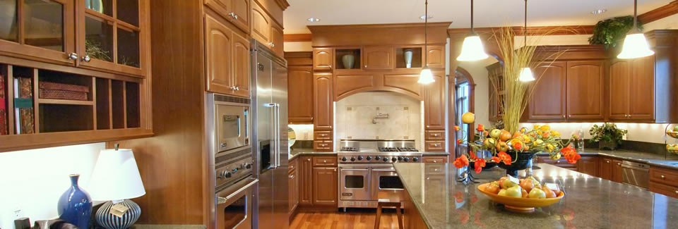 /pine-by-design-kitchen-case-studies/large-mahogany-kitchen-with-grand-over-mantle-woodwork-creates-the-focus-of-the-home