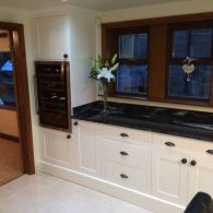 Handmade Kitchen (and Hand Painted) with Builtin Wine Cooler